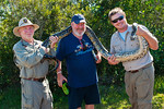 NPS Volunteer Wayne and Nick let Gaetan get up close and personal with an invasive python